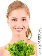Купить «Юная девушка с пучком зелени в руках», фото № 4093070, снято 15 августа 2009 г. (c) Syda Productions / Фотобанк Лори