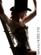 Купить «Силуэт женщины в корсете и шляпе со стремянкой», фото № 4093110, снято 30 сентября 2009 г. (c) Syda Productions / Фотобанк Лори