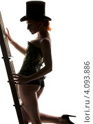 Купить «Силуэт женщины в корсете и шляпе со стремянкой», фото № 4093886, снято 30 сентября 2009 г. (c) Syda Productions / Фотобанк Лори