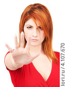 Купить «Привлекательная молодая женщина показывает на руках жест стоп на белом фоне», фото № 4107670, снято 10 октября 2009 г. (c) Syda Productions / Фотобанк Лори