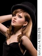 Купить «Сексуальная девушка в черном на темном фоне», фото № 4109678, снято 28 октября 2009 г. (c) Syda Productions / Фотобанк Лори
