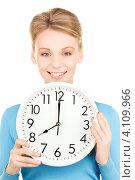 Купить «Молодая женщина с круглыми часами на белом фоне», фото № 4109966, снято 12 декабря 2009 г. (c) Syda Productions / Фотобанк Лори