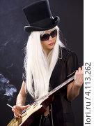 Купить «Стройная девушка с длинными белыми волосами и гитарой курит на темном фоне», фото № 4113262, снято 29 декабря 2008 г. (c) Syda Productions / Фотобанк Лори