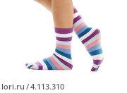 Купить «Стройные женские ноги в полосатых носках на белом фоне», фото № 4113310, снято 16 марта 2007 г. (c) Syda Productions / Фотобанк Лори