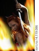 Купить «Рыжая дьяволица в огне на черном фоне», фото № 4119086, снято 9 апреля 2007 г. (c) Syda Productions / Фотобанк Лори