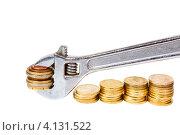 Купить «Разводной ключ и монеты», фото № 4131522, снято 26 ноября 2012 г. (c) Mikhail Starodubov / Фотобанк Лори