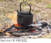 Чайник на огне. Стоковое фото, фотограф Леонид Русанов / Фотобанк Лори