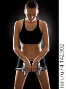 Купить «Молодая спортивная девушка с гантелью на черном фоне», фото № 4142902, снято 13 октября 2011 г. (c) CandyBox Images / Фотобанк Лори