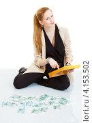 Купить «Женщина со счетами и кучей денег», фото № 4153502, снято 1 декабря 2012 г. (c) Сергей Дубров / Фотобанк Лори