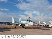 Купить «Жуковский, 100 лет ВВС России. Су-27 — многоцелевой высокоманевренный всепогодный истребитель четвёртого поколения», фото № 4154074, снято 11 августа 2012 г. (c) Игорь Долгов / Фотобанк Лори