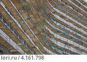Купить «Здание в строительных лесах», фото № 4161798, снято 10 ноября 2012 г. (c) Вячеслав Палес / Фотобанк Лори