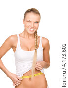 Купить «Стройная девушка в белом белье измеряет сантиметром свои объемы», фото № 4173602, снято 8 мая 2010 г. (c) Syda Productions / Фотобанк Лори