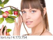Купить «Привлекательная юная девушка с веткой, усыпанной яблоками», фото № 4173754, снято 13 марта 2010 г. (c) Syda Productions / Фотобанк Лори