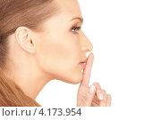 Купить «Привлекательная девушка с указательным пальцем у губ на белом фоне», фото № 4173954, снято 14 марта 2010 г. (c) Syda Productions / Фотобанк Лори