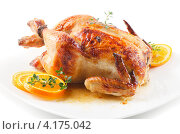 Жареный цыпленок с апельсинами. Стоковое фото, фотограф Tatjana Baibakova / Фотобанк Лори
