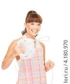Купить «Молодая домохозяйка в клетчатом фартуке с миксером в руках», фото № 4180970, снято 27 июня 2010 г. (c) Syda Productions / Фотобанк Лори