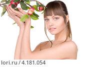 Купить «Юная девушка с яблоневой веткой с яблоками на белом фоне», фото № 4181054, снято 13 марта 2010 г. (c) Syda Productions / Фотобанк Лори