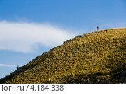 Купить «Каменистый склон с маленькой фигуркой человека», фото № 4184338, снято 28 июля 2012 г. (c) Борис Панасюк / Фотобанк Лори