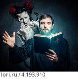 Купить «Мужчина в чёрной рясе с Библией в руках и женщина в образе демона», фото № 4193910, снято 6 января 2013 г. (c) Alexander Tihonovs / Фотобанк Лори