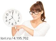 Купить «Веселая молодая женщина с круглыми большими часами на белом фоне», фото № 4195702, снято 27 июня 2010 г. (c) Syda Productions / Фотобанк Лори