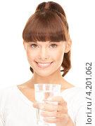 Купить «Счастливая девушка пьет из стакана на белом фоне», фото № 4201062, снято 27 июня 2010 г. (c) Syda Productions / Фотобанк Лори
