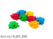 Разноцветный пластмассовый конструктор на белом фоне. Стоковое фото, фотограф Евгений Заржицкий / Фотобанк Лори