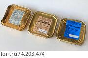 Купить «Современная упаковка косервов», эксклюзивное фото № 4203474, снято 16 декабря 2012 г. (c) Анатолий Матвейчук / Фотобанк Лори