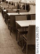 Купить «Открытое уличное кафе. Тонировано в сепию», фото № 4206070, снято 4 августа 2012 г. (c) Анастасия Золотницкая / Фотобанк Лори