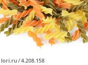 Купить «Разноцветные витые сухие макароны на белом фоне», фото № 4208158, снято 16 января 2013 г. (c) Воронин Владимир Сергеевич / Фотобанк Лори