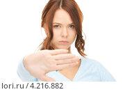 Купить «Расстроенная девушка просит остановиться, выставив руку вперед», фото № 4216882, снято 11 сентября 2010 г. (c) Syda Productions / Фотобанк Лори