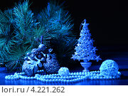 Купить «Новогодняя композиция с елочными украшениями в синих тонах и маленькой елочкой», фото № 4221262, снято 26 сентября 2012 г. (c) Sergey Nivens / Фотобанк Лори