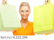 Купить «Счастливая молодая женщина держит в руках покупки в бумажных пакетах на белом фоне», фото № 4222294, снято 18 сентября 2010 г. (c) Syda Productions / Фотобанк Лори