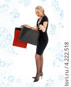 Купить «Счастливая молодая женщина держит в руках покупки в бумажных пакетах на белом фоне», фото № 4222518, снято 12 марта 2007 г. (c) Syda Productions / Фотобанк Лори