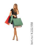Купить «Счастливая молодая женщина держит в руках покупки в бумажных пакетах на белом фоне», фото № 4222558, снято 14 августа 2010 г. (c) Syda Productions / Фотобанк Лори
