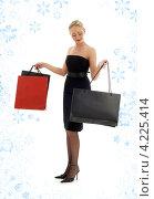 Купить «Привлекательная молодая женщина возвращается из магазина с покупками в пакетах», фото № 4225414, снято 12 марта 2007 г. (c) Syda Productions / Фотобанк Лори