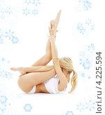 Купить «Стройная блондинка занимается йогой на белом фоне со снежинками», фото № 4225594, снято 27 октября 2007 г. (c) Syda Productions / Фотобанк Лори