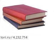 Стопка из трех книг на белом фоне. Стоковое фото, фотограф Михаил Голубев / Фотобанк Лори