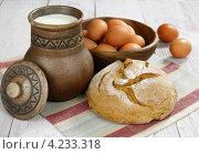 Купить «Хлеб, молоко и яйца», фото № 4233318, снято 2 декабря 2012 г. (c) Надежда Мишкова / Фотобанк Лори