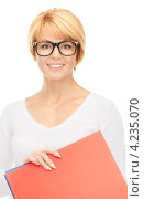 Купить «Молодая деловая женщина с яркими папками на белом фоне», фото № 4235070, снято 26 сентября 2010 г. (c) Syda Productions / Фотобанк Лори