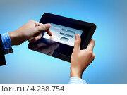 Купить «Современные технологии. Руки вводят логин и пароль электронной почты на экране планшета на синем фоне», фото № 4238754, снято 5 ноября 2012 г. (c) Sergey Nivens / Фотобанк Лори