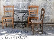 Купить «Три стула и один стол», фото № 4273774, снято 1 мая 2010 г. (c) Victor Spacewalker / Фотобанк Лори