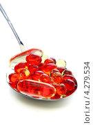 Купить «Капсулы с витаминами в столовой ложке», фото № 4279534, снято 10 февраля 2013 г. (c) Марина Сапрунова / Фотобанк Лори