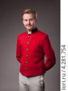Портрет консьержа в красном жакете на сером фоне. Стоковое фото, фотограф Vycheslav Leskovskiy / Фотобанк Лори