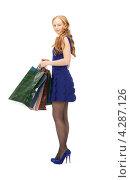 Купить «Счастливая рыжая девушка с длинными волосами и пакетами покупок в руках», фото № 4287126, снято 27 ноября 2010 г. (c) Syda Productions / Фотобанк Лори