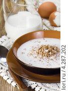 Купить «Каша гречневая с молоком», эксклюзивное фото № 4287202, снято 8 февраля 2013 г. (c) Александр Курлович / Фотобанк Лори