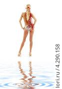 Купить «Стройная девушка в бикини в золотых туфлях на высоких каблуках», фото № 4290158, снято 15 августа 2006 г. (c) Syda Productions / Фотобанк Лори