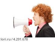 Купить «Рыжий молодой человек с мегафоном на белом фоне», фото № 4291678, снято 26 февраля 2011 г. (c) Syda Productions / Фотобанк Лори