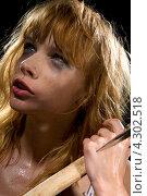 Купить «Расстроенная девушка со слезами на глазах и с топором в руках», фото № 4302518, снято 20 июня 2008 г. (c) Syda Productions / Фотобанк Лори