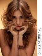 Купить «Красивая молодая женщина с длинными волнистыми волосами», фото № 4308170, снято 1 сентября 2011 г. (c) Syda Productions / Фотобанк Лори
