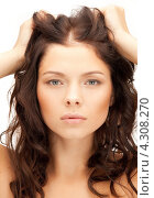 Купить «Красивая молодая женщина с длинными волнистыми волосами», фото № 4308270, снято 18 июля 2011 г. (c) Syda Productions / Фотобанк Лори